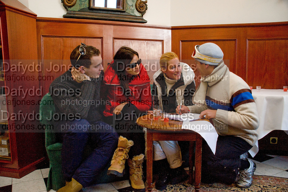 LORD FREDERICK WINDSOR; SOPHIE WINKLEMAN; ALEXANDRA BLOSS OWENS; PRINCE VALERIO MASSIMO DI ROCCASECCA studying questions.  Bar, Palace Hotel.  PISTE AGAIN) Treasure Hunt in aid of the Knights of Malta,  St. Moritz, Switzerland. 23 January 2009 *** Local Caption *** -DO NOT ARCHIVE-© Copyright Photograph by Dafydd Jones. 248 Clapham Rd. London SW9 0PZ. Tel 0207 820 0771. www.dafjones.com.<br /> LORD FREDERICK WINDSOR; SOPHIE WINKLEMAN; ALEXANDRA BLOSS OWENS; PRINCE VALERIO MASSIMO DI ROCCASECCA studying questions.  Bar, Palace Hotel.  PISTE AGAIN) Treasure Hunt in aid of the Knights of Malta,  St. Moritz, Switzerland. 23 January 2009