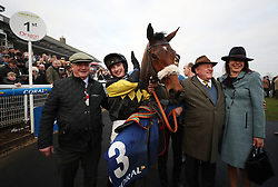 Tom O'Brien celebrates his victory in the Coral Welsh Grand National Handicap Chase with owner John Romans (right) and trainer Colin Tizzard (left) during the Coral Welsh Grand National day at Chepstow Racecourse.
