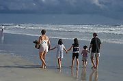 Family walking along the seashore