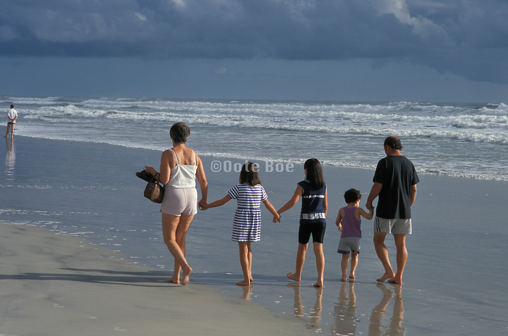 Family walking along the seashore