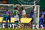 João Palhinha and Sebastián Coates head shoot during the Liga NOS match between Sporting Lisbon and Belenenses SAD at Estadio Jose Alvalade, Lisbon, Portugal on 21 April 2021.