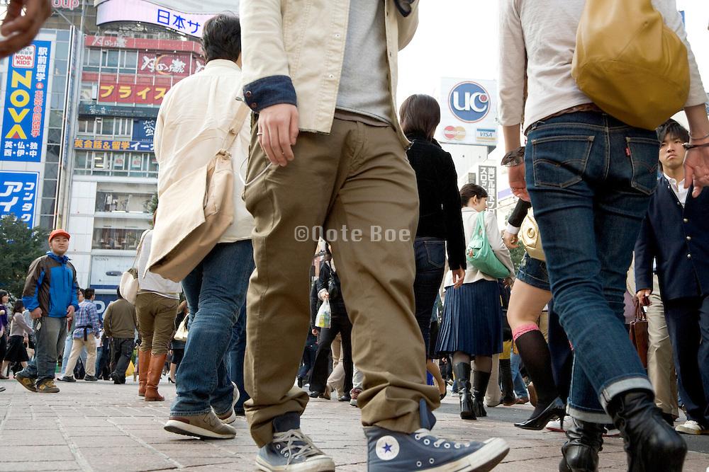 young people crossing at Shibuya Tokyo Japan
