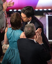 © Licensed to London News Pictures . 06/05/2015 . Leeds , UK . The leader of the Labour Party , Ed Miliband , arrives and kisses his wife Justine Thornton , to address an election rally at Leeds City Museum , on the eve of polls opening for the 2015 British general election . Photo credit : Joel Goodman/LNP