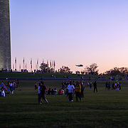 A VH-3D Sea King from HMX-1, Known for carrying the president flies over the national mall. People from Baltimore-Washington Area gather around the White House to celebrate the announcement of Joe Biden's election as the Next President of the United States.