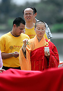 SHOT 7/28/2007 - A Buddhist monk blesses some of the Dragon Boats during the Dotting of the Eyes ceremony at the 2007 Colorado Dragon Boat Festival. Dragon Boats are awakened, or given life, during the traditional Dotting of the Eyes ceremony. The sport of Dragon boat racing is over 2000 years old and features teams of 18 paddlers - nine men and nine women plus someone to steer the boat all rowing to the beat of a drum and racing to a flag 200 meters away on Sloan's Lake in Denver, Co. Founded in 2001 to celebrate Denver?s rich Asian Pacific American culture, the Colorado Dragon Boat Festival has become the region?s fastest growing and most acclaimed new festival. Festival-goers get to explore the Asian culture through demonstrations, crafts, shopping, eating, and the growing sport of dragon boat racing. .(Photo by Marc Piscotty / © 2007)