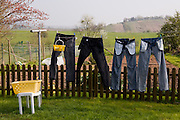 Carlo and Marie Paule Kutten-Kass clothes drying on a line in the back garden of house in the town of Erpeldange in Bous, southeast of Luxembourg City, near the German border. Grand Duchy of Luxembourg. The image is part of a collection of images and documentation for Hungry Planet 2, a continuation of work done after publication of the book project Hungry Planet: What the World Eats.