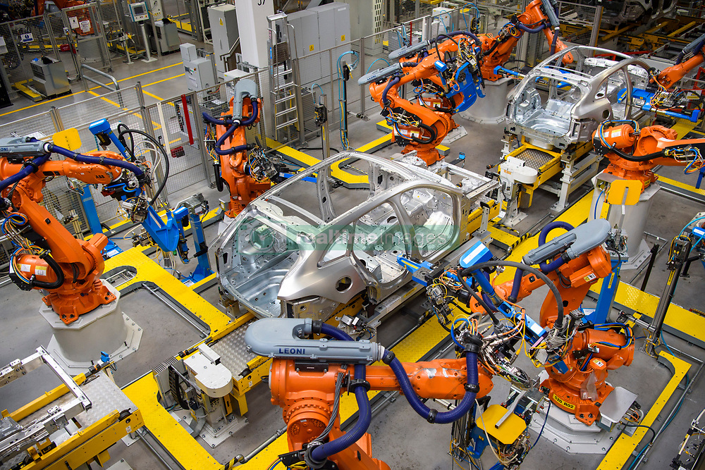 Robotic arms rivet car panels together in the Aluminium Body Shop, part of Jaguar Land Rover's Advanced Manufacturing Facility in Solihull, Birmingham. Picture date: Wednesday March 15th, 2017. Photo credit should read: Matt Crossick/ EMPICS. Aluminium Body Shop 3 is Europe's largest aluminium body shop, and contains nearly 800 robots building Jaguar F-Pace and Range Rover Velar cars. It is capable of producing an aluminium car body every 76 seconds.