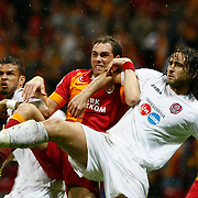 Galatasaray's  Johan Elmander (L) and CFR Cluj's Felice Piccolo (R) during their UEFA Champions League Group H matchday 3 soccer match Galatasaray between CFR Cluj at the TT Arena Ali Sami Yen Spor Kompleksi in Istanbul, Turkey on Tuesday 23 October 2012. Photo by Aykut AKICI/TURKPIX