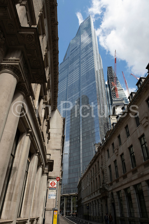 Old and new architecture in the City of London with older classical buildngs and the modernism of 100 Bishopsgate on 26th May 2021 in London, United Kingdom. As the financial district grows in height, the architecture has changed the face of London with many different companies occupying the various floors and levels, some of which remain empty as overseas investments.