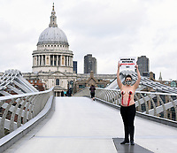 """PETA Protester to Show Solidarity for Mother Cows Exploited for Milk<br /> <br />  Daniella Wood Shirtless and with her nipples caked in """"blood"""", a pregnant PETA supporter will protest at Millennium Bridge ahead of Mother's Day to highlight the plight of mother cows used and abused on dairy farms, many of whom develop mastitis – painful inflammation of the mammary glands – caused by the easy spread of bacteria on filthy dairy farms. <br /> Cows on such farms are artificially inseminated – farmers insert an arm into the animals' rectum and a metal rod into the vagina – and their calves are taken from them within a day of birth so that humans can consume the milk that was meant for them. Male calves are frequently shipped off to mainland Europe to be tormented and slaughtered to make veal, while females endure the same fate as their mothers: repeated forced pregnancies until their bodies eventually break down, at which point they're slaughtered for cheap meat. Each person who goes vegan saves the lives of nearly 200 animals every year.photo by <br /> Krisztian Elek<br /> <br />                       ,"""