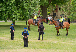 © Licensed to London News Pictures; 16/05/2020; Bristol, UK. Police patrol on Brandon Hill in Bristol, one of two locations in the city where a mass gathering protest against the lockdown restrictions of the Covid-19 coronavirus pandemic had been advertised. No mass gathering was visible, but there was a small protest gathering elsewhere in the city in Victoria Park. Restrictions have been eased by the UK government but people should still not gather in groups of more than two people not in the same household or in groups of more than two people outside of their own household. Photo credit: Simon Chapman/LNP.