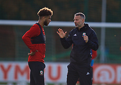 CARDIFF, WALES - Wednesday, November 14, 2018: Wales' manager Ryan Giggs (R) speaks with Tyler Roberts during a training session at the Vale Resort ahead of the UEFA Nations League Group Stage League B Group 4 match between Wales and Denmark. (Pic by David Rawcliffe/Propaganda)