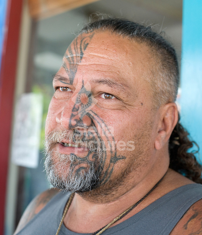 Picture by Daniel Hambury. .12/1/11..A local Maori man carves in Coromandel Town, New Zealand