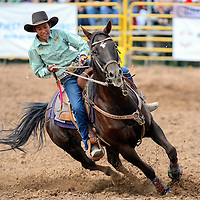 090713  Adron Gardner/Independent<br /> <br /> Peyton Murphy rounds the first turn during the barrel racing competition at the Navajo Nation Fairgrounds in Window Rock Saturday.