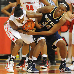 Rutgers Scarlet Knights guard Syessence Davis (15) forces a held-ball turnover on Notre Dame Fighting Irish forward Markisha Wright (34) during second half NCAA Big East women's basketball action between Notre Dame and Rutgers at the Louis Brown Athletic Center. Notre Dame defeated Rutgers 71-41.