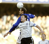 Photo: Aidan Ellis.<br /> Everton v Chelsea. The FA Cup. 28/01/2006.<br /> Everton's Duncan Ferguson beats Chelsea's John Terry to the ball