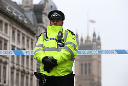 A police officer in Parliament Square in London, after seven people were arrested in raids in London, Birmingham and elsewhere linked to the Westminster terror attack.