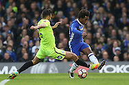 Ryan Tafazolli of Peterborough United intercepts Willian of Chelsea. The Emirates FA cup, 3rd round match, Chelsea v Peterborough Utd at Stamford Bridge in London on Sunday 8th January 2017.<br /> pic by John Patrick Fletcher, Andrew Orchard sports photography.