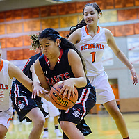 Grants Pirate Angelica Nanez (4) grabs a rebound away from the Gallup Bengals Thursday at Gallup High School.