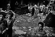 Manchiet Nasr. boys plays with kite in the streets between the garbage.
