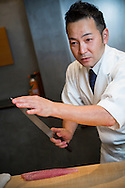 Master chef Keita Tarikino is working with his honyaki yanagi knife, also called sashimi knife. This type of knife is used for cutting parts of fish and seafood after it has been prepared with another knife and cointains no bones, scales or shells.<br /> <br /> Restaurant Kappou Ukai in Ginza, Tokyo