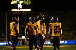 California offensive players await the resumption of play during the fourth quarter of an NCAA college football game, Saturday, Sept. 4, 2021, in Berkeley, Calif. (AP Photo/D. Ross Cameron)