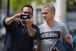 © Licensed to London News Pictures. 27/05/2016. London, UK.  JOSE MOURINHO poses for a selfie with Portuguese Man U fan, STEVEN RIBEIRO, as he returns to  his home in west London on the day he was officially announced as the new manager of Manchester United Football Club. Photo credit: Ben Cawthra/LNP
