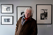 A portrait of documentary photographer, Homer Sykes while at his exhibition of his Once a Year: Some Traditional British Customs work, being shown at the Lucy Bell Gallery in St Leonards, on 3rd May 2021, in St Leonards, Sussex, England.