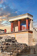Minoan of the North Entrance Propylaeum with its painted charging  bull releif,  Knossos Palace archaeological site, Crete. At sunset. ..<br /> <br /> Visit our GREEK HISTORIC PLACES PHOTO COLLECTIONS for more photos to download or buy as wall art prints https://funkystock.photoshelter.com/gallery-collection/Pictures-Images-of-Greece-Photos-of-Greek-Historic-Landmark-Sites/C0000w6e8OkknEb8 <br /> .<br /> Visit our MINOAN ART PHOTO COLLECTIONS for more photos to download  as wall art prints https://funkystock.photoshelter.com/gallery-collection/Ancient-Minoans-Art-Artefacts-Antiquities-Historic-Places-Pictures-Images-of/C0000ricT2SU_M9w