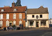 People sitting outside a cafe, Framlingham, Suffolk, England