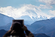 photographing mount Fuji with an Ipad from Meiji no Mori Takao Quasi-National Park Japan  Tokyo Hachioji ward