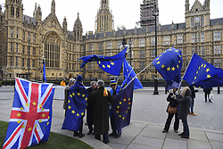 February 6, 2018 - London, England, United Kingdom - Demonstrators wave EU and Union flags outside the Houses of Parliament, London on February 6, 2018. Michel Barnier has warned that Britain will inevitably face barriers to trade in both goods and services if it chooses to leave the customs union and single market, following a critical meeting in Downing street with Theresa May and David Davis. (Credit Image: © Alberto Pezzali/NurPhoto via ZUMA Press)