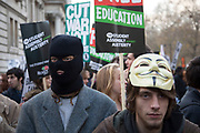 London, UK. Wednesday 19th November 2014. Student Assembly Against Austerity demonstration in protest at education spending cuts, tuition fees, and the resulting students debt. Protester wearing a balaclava.