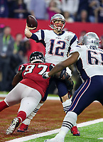 New England Patriots quarterback Tom Brady (12) looks to pass during the NFL Super Bowl LI football game  against the Atlanta Falcons on Sunday, Feb. 05, 2017 in Houston. The Patriots defeated the Falcons 34-28 in overtime.<br /> <br /> (Tom DiPace)
