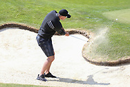 Kevin Pietersen chips out of a bunker on the 18th hole during the Celebrity Pro-Am day at Wentworth Club, Virginia Water, United Kingdom on 23 May 2018. Picture by Phil Duncan.