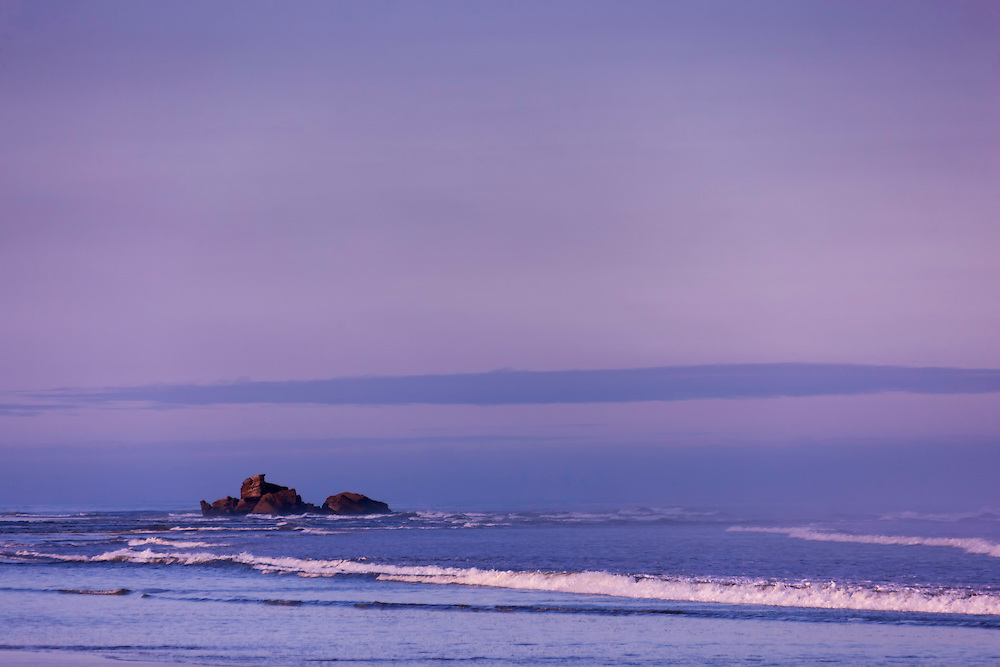 Beach with rocks in the water at dawn, Essaouira, Morocco.