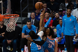 March 10, 2018 - Los Angeles, CA, U.S. - LOS ANGELES, CA - MARCH 10: Orlando Magic forward Wesley Iwundu (25) gets an arm to the face by LA Clippers forward Montrezl Harrell (5) as he goes to the basket during the game between the Orlando Magic and the LA Clippers on March 10, 2018, at STAPLES Center in Los Angeles, CA. (Photo by David Dennis/Icon Sportswire) (Credit Image: © David Dennis/Icon SMI via ZUMA Press)