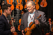Paul Dulude, right, shows a violin to Johnny Weizenecker, a music student at Gettysburg College.