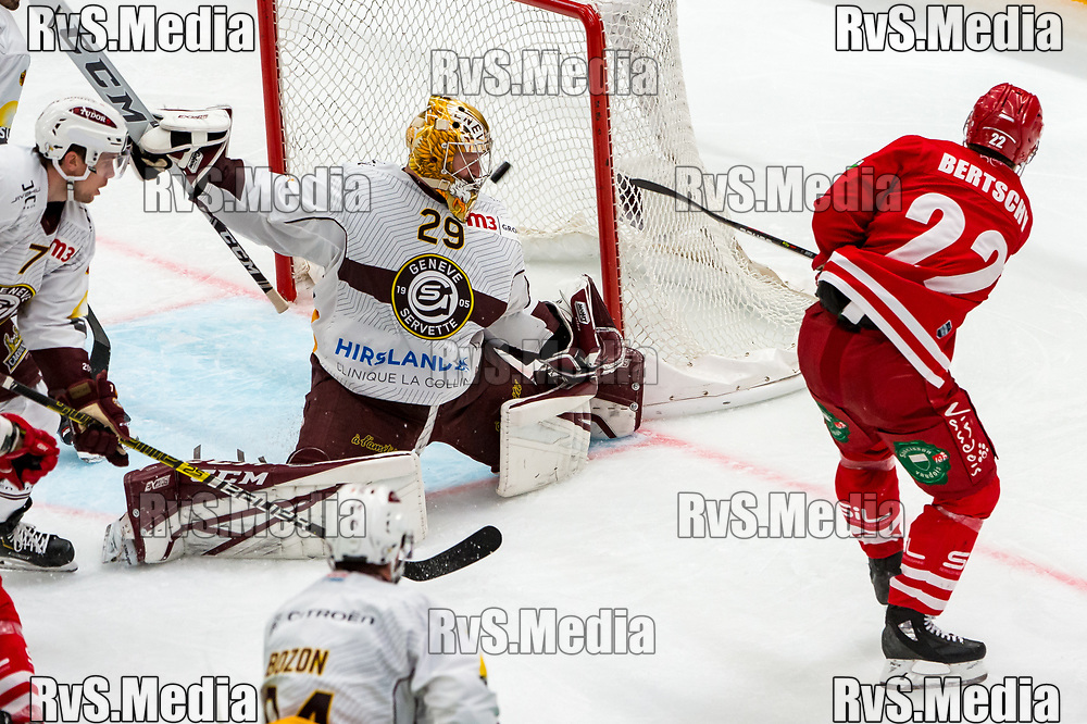 LAUSANNE, SWITZERLAND - NOVEMBER 23: #22 Christoph Bertschy of Lausanne HC tries to score against #29 Goalie Robert Mayer of Geneve-Servette HC during the Swiss National League game between Lausanne HC and Geneve-Servette HC at Vaudoise Arena on November 23, 2019 in Lausanne, Switzerland. (Photo by Robert Hradil/RvS.Media)