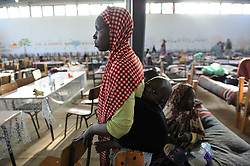 Migrants stop by a transit centre in Laghouate, Algeria, June 28, 2018 on their way from Algiers to Tamanrasset, 2,000 km south of Algiers. Nigerian illegal migrants (majority of women and children) who lived in Algeria by begging, according to the Algerian authorities, will be returned to their country once the administrative arrangements are completed. Photo by Louiza Ammi/ABACAPRESS.COM