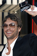 Kevin Federline, husband of the famous singer Britney Spears, is showing his Virgin mobile phone moments before signing a petition in collaboration with Virgin, during a Virgin Mobile promotion event at Time Square, New York, on Wednesday, June 21, 2006. The petition against the abolition of the Penny coin, sponsored by Virgin Mobile, will be then sent over to lawyers in Washington. After this extraordinary event, Virgin Mobile will allow customers to buy 1000 text messages a month for only $9.99, just one humble penny per text.  **ITALY OUT**