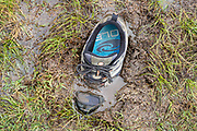 "Atop the Quiraing plateau, my shoe stuck in sucky mud. The Quiraing (or Cuith-Raing in Gaelic, from Norse words meaning ""round fold"") is a landslip on the eastern face of Meall na Suiramach, the northernmost summit of the Trotternish Peninsula on the Isle of Skye, Scotland, United Kingdom, Europe. We hiked a muddy loop on the Quiraing, 4.5 miles with 1200 feet gain. The Trotternish Ridge escarpment was formed by a great series of landslips, of which the Quiraing portion is still moving, causing the road at its base, near Flodigarry, to require repairs each year."