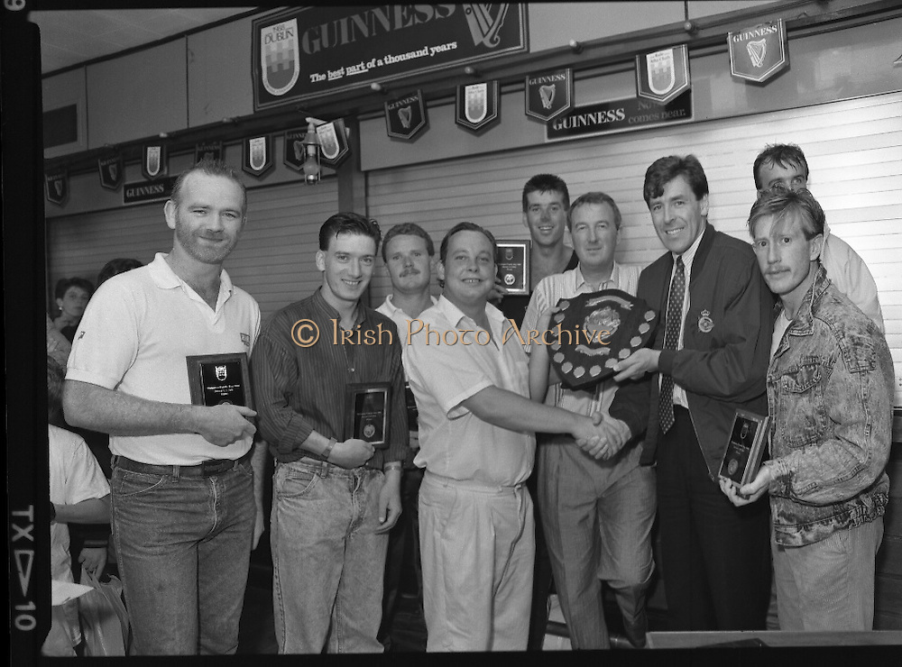 """Guinness Family Day At The Iveagh Gardens. (R83)..1988..02.07.1988..07.02.1988..2nd  July 1988..The family fun day for Guinness employees and their families took place at the Iveagh Gardens today. Top at the bill at the event were """"The Dubliners"""" who treated the crowd to a performance of all their hits. Ireland's penalty hero from Euro 88, Packie Bonner, was on hand to sign autographs for the fans...Packier Bonner is pictured presenting the prizes to the seven a side soccer winners."""