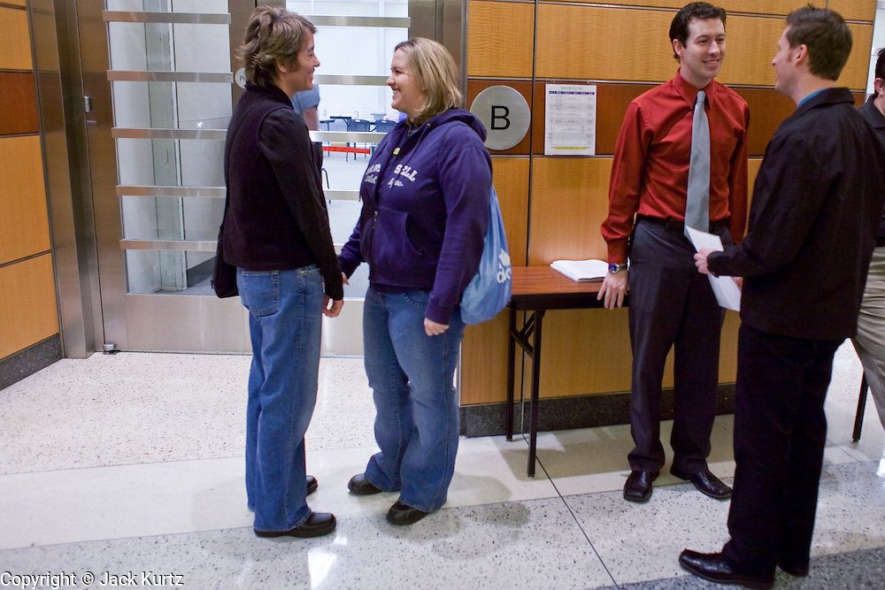 Feb. 9, 2009 -- PHOENIX, AZ: LISA SMITH, left, her partner, REGAN BENNION and JARED WEST and his partner, RONNIE CONNER wait to register as partners in the Phoenix City Hall. The city of Phoenix initiated its Domestic Partners Registry for city residents Monday morning. Under the terms of the registry, unmarried couples, whether gay or straight, can register as domestic partners to gain visitation and decision making rights if one of them, or one of their children, is hospitalized. They were the first and second couples to publicly register as domestic partners. Gay and domestic partner rights has become a hot button issue in Arizona since voters in the state passed an anti-gay marriage amendment in November that defines marriage as being between one man and one woman.  PHOTO BY JACK KURTZ