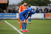 AFC Wimbledon striker Joe Pigott (39) with hands on knees and shirt over head after the final whistle during the EFL Sky Bet League 1 match between AFC Wimbledon and Blackpool at the Cherry Red Records Stadium, Kingston, England on 22 February 2020.