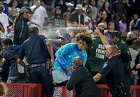 A police officer sprays pepper spray to break up a fight in the stands during the second quarter as the Sacramento Dragons host the Folsom Bulldogs varsity football team at Hughes Stadium at Sacramento City College, Friday Sep 15, 2017.<br /> photo by Brian Baer