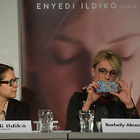 """Actress Alexandra Borbely (R) of Hungary takes a photo with her mobile phone of the Golden Bear statue won by her movie """"On Body and Soul"""" during a press conference in Budapest, Hungary on February 21, 2017. ATTILA VOLGYI"""