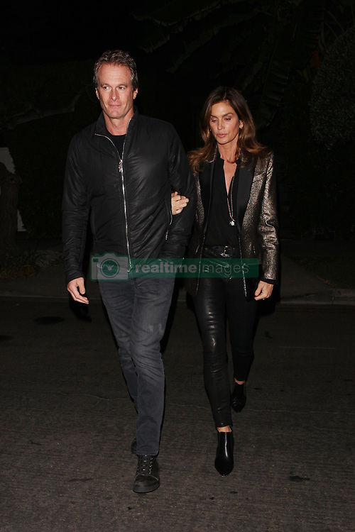 **PREMIUM EXCLUSIVE** Cindy Crawford and Rande Gerber are seen attending a fundraiser held at Gerard Butler's house for the Malibu Fire Relief in West Hollywood. The couple enjoyed themselves at the charity event. They arrived to Gerard's house at 6:30 P.M. and left at 10:15 P.M. Pizza seemed to be the main course at the fundraiser. Cindy is seen holding a slice of pizza in hand as they leave the house. Butler, Robin Thicke, and Miley Cyrus were among thousands who lost their homes to the blazes, which have killed at least 74 people across the state. Up to a thousand are still unaccounted for. The 300 star invited his A-list friends to his West Hollywood home for the cause, hoping to raise at least $1million for fire relief. Remains of at least 74 people have been recovered so far in California. 71 of the victims are from the Camp Fire around the Sierra foothills hamlet of Paradise and three are from the Woolsey Fire near Los Angeles. Of the dead, 13 victims are yet to be identified. The once picturesque town was home to nearly 27,000 residents before it was largely incinerated by the deadly Camp Fire on the night of November 8. More than a week later, a team of more than 9,000 firefighters have managed to carve containment lines around 45 percent of the blaze's perimeter, up from 35 percent a day earlier. The powerful fire razed through more than 142,000 acres in a little over a week. Nearly 12,000 homes and buildings, including most of the town of Paradise, were incinerated hours after the blaze erupted, the California Department of Forestry and Fire Protection (Cal Fire) has said. Thousands of additional structures are still threatened by the Camp Hill fire, and as many as 50,000 people were under evacuation orders at the height of the blaze. 17 Nov 2018 Pictured: Cindy Crawford and Rande Gerber. Photo credit: Rachpoot/MEGA TheMegaAgency.com +1 888 505 6342