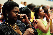 Parent Susie Travis celebrates the graduation of her daughter Camille at Christ the King Jesuit College Preparatory School on Saturday, June 9th 2012. The institution is a beacon of hope amid one of the city's most impoverished neighborhoods, bucking low graduation rate trends with a 100% graduation and college acceptance rate. Brian J. Morowczynski~ViaPhotos..For use in a single edition of Catholic New World Publications, Archdiocese of Chicago. Further use and/or distribution may be negotiated separately. ..Contact ViaPhotos at 708-602-0449 or email brian@viaphotos.com.