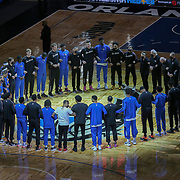 ORLANDO, FL - APRIL 12: Orlando Magic and San Antonio Spurs players stand in a circle during the United States national anthem at Amway Center on April 12, 2021 in Orlando, Florida. NOTE TO USER: User expressly acknowledges and agrees that, by downloading and or using this photograph, User is consenting to the terms and conditions of the Getty Images License Agreement. (Photo by Alex Menendez/Getty Images)*** Local Caption ***